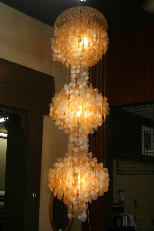 Exceptional 3 Tier Capiz Shell Chandelier. $250.00, Via Etsy.