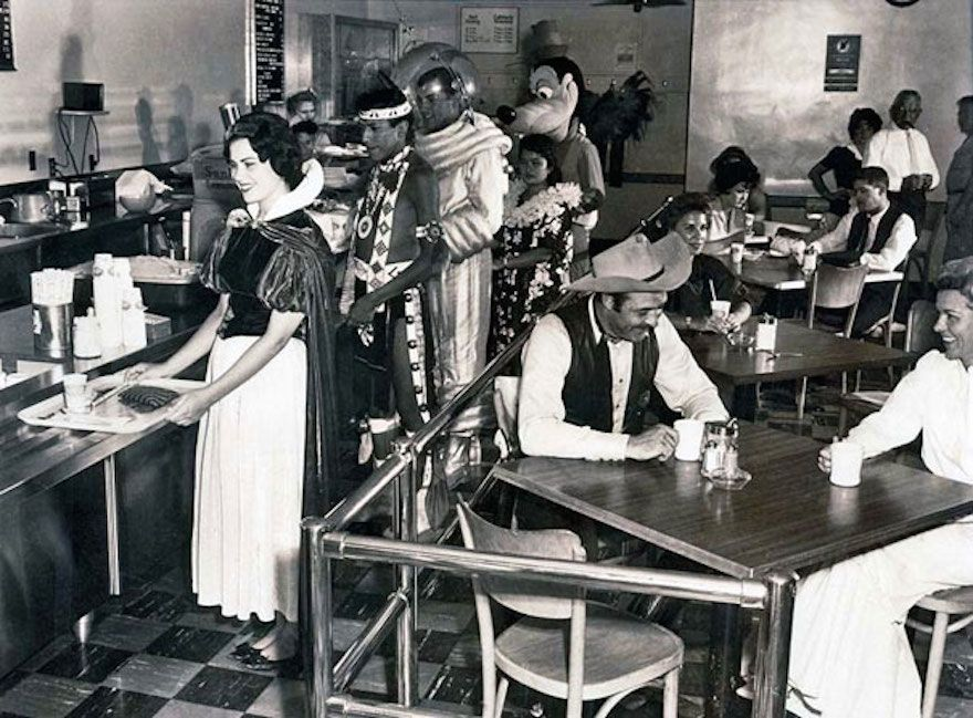 A dream diner! Snow White and Pluto just waiting in line for some food at a cafeteria for Disneyland Employees in 1961.