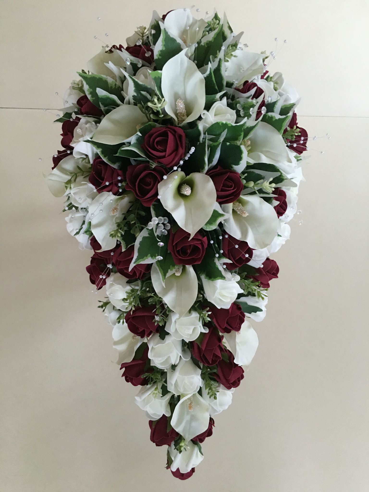 Wedding bouquets teardrop  Brides teardrop bouquet with cala lilies ivory and burgundy roses