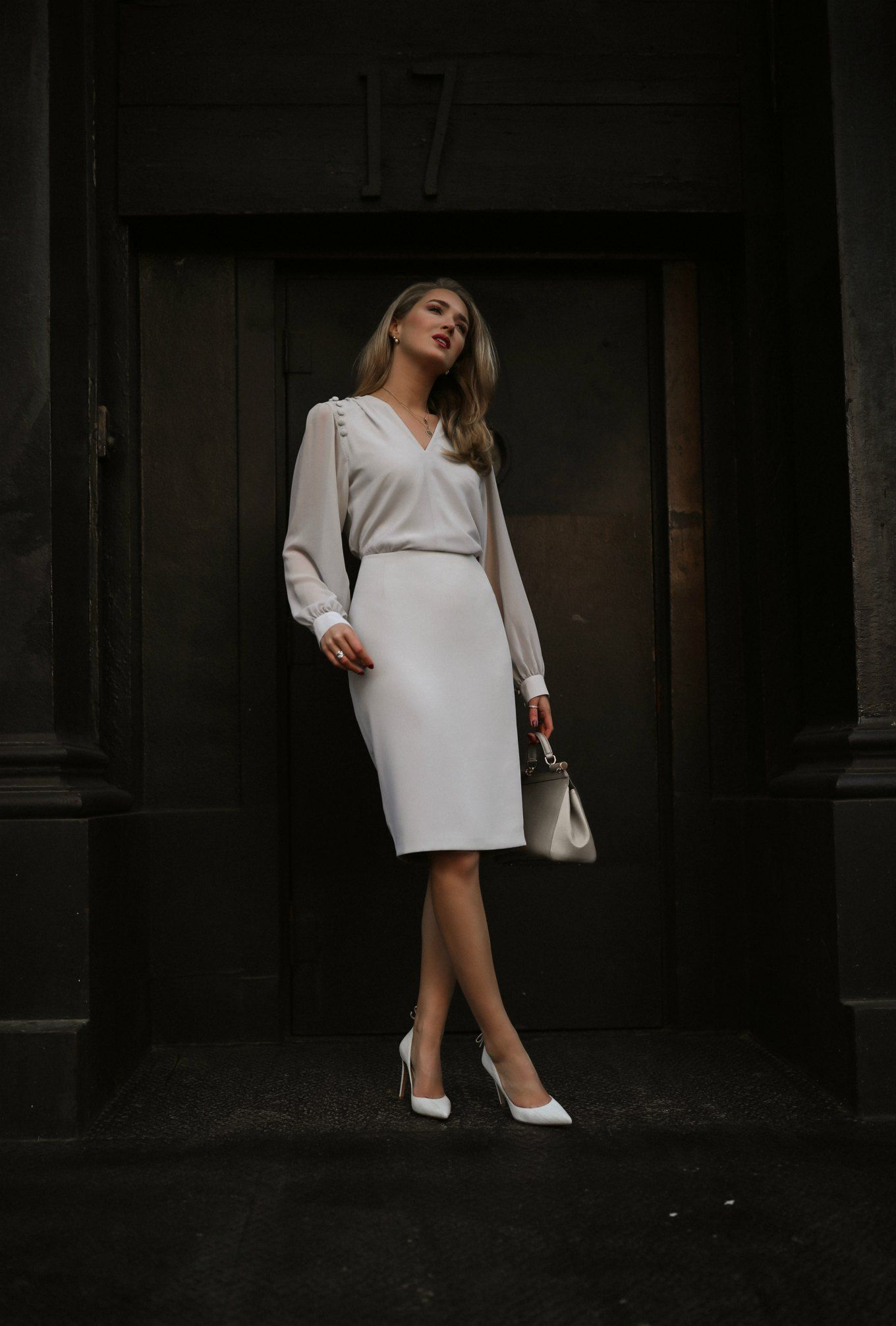 NYC style blogger Mary Orton in light grey dress with long