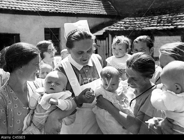 Nurse with mothers and babies, 1938
