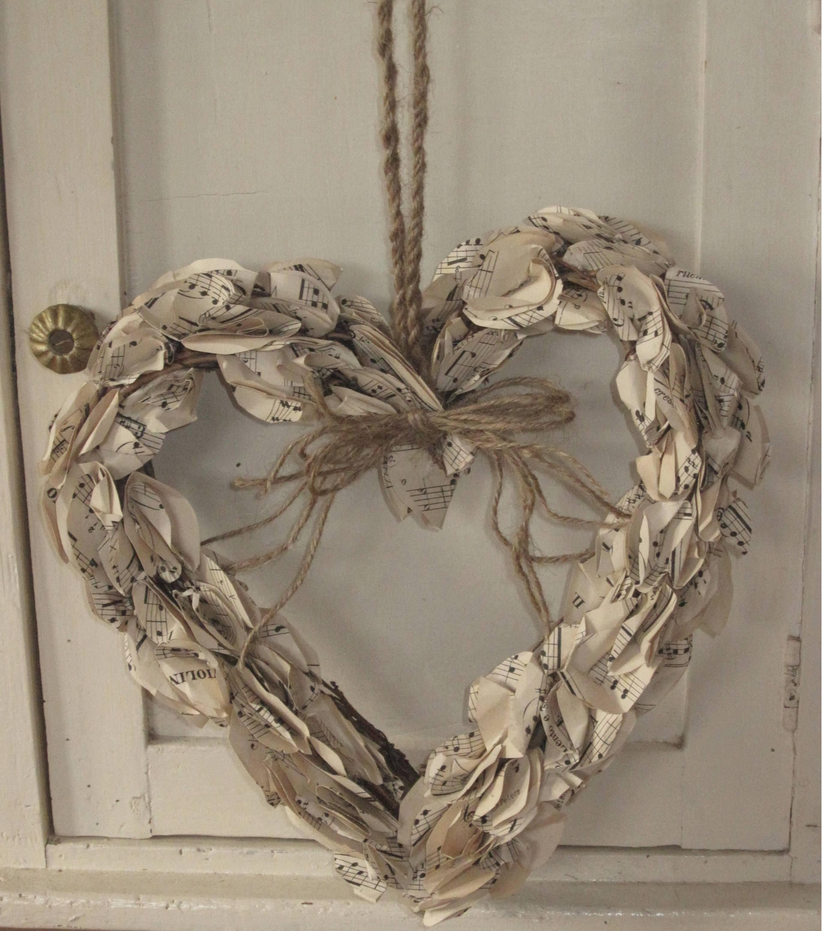Wooden heart shabby chic with old sheet music