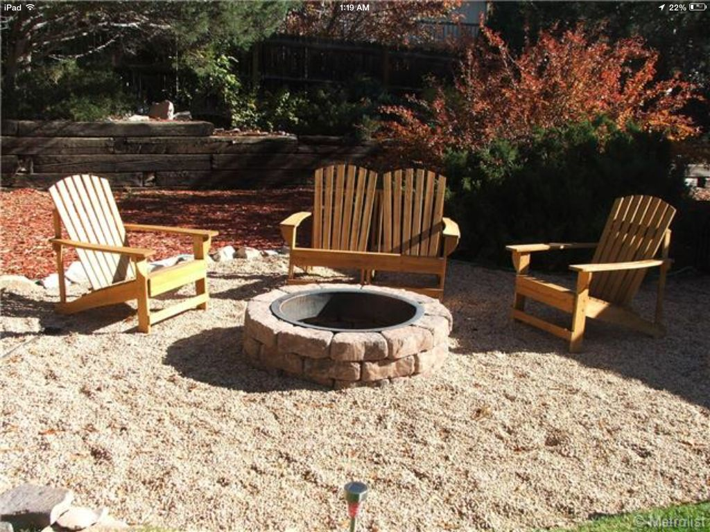 pea gravel patio, adirondacks, fire pit, large cobble border