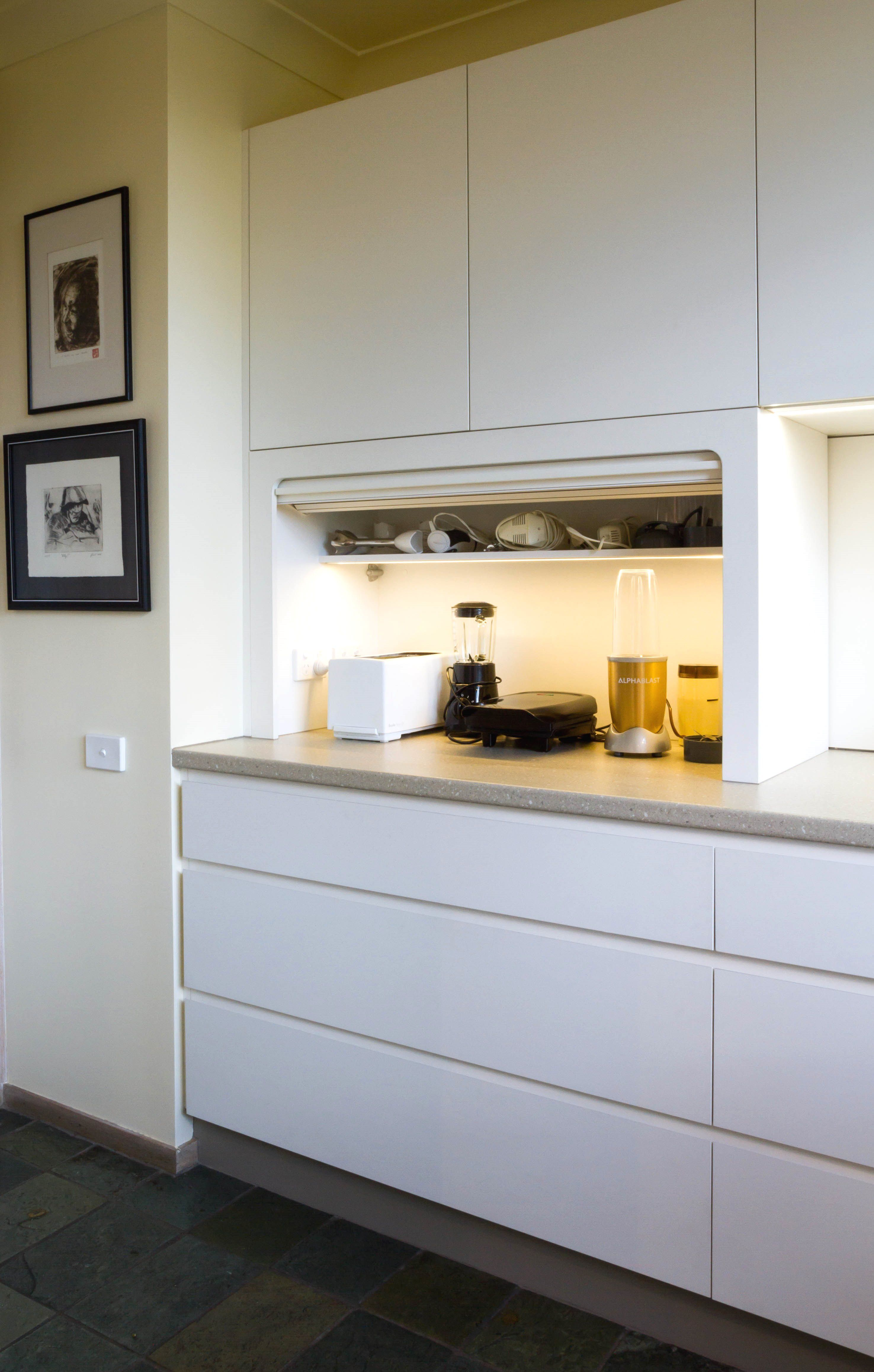 Stunning Handle Less Kitchen With An Incredible View Roller Door