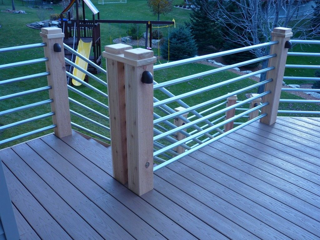 Custom railing system with cedar posts and galvanized pipe ...