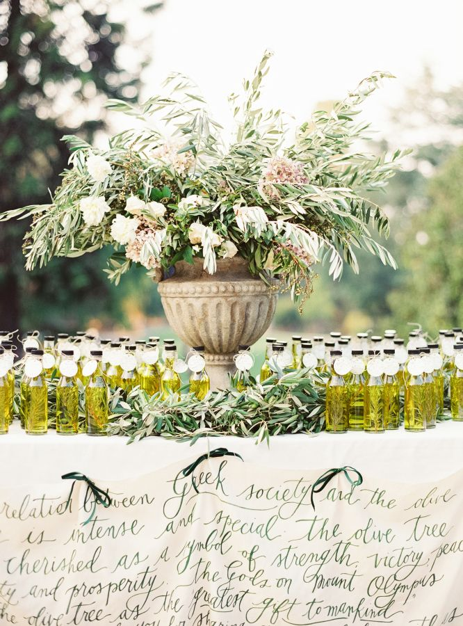 Gorgeous olive oil escort card + favor display: http://www.stylemepretty.com/2016/02/16/english-garden-style-wedding-in-california/   Photography: Michele Beckwith - http://michelebeckwith.com/