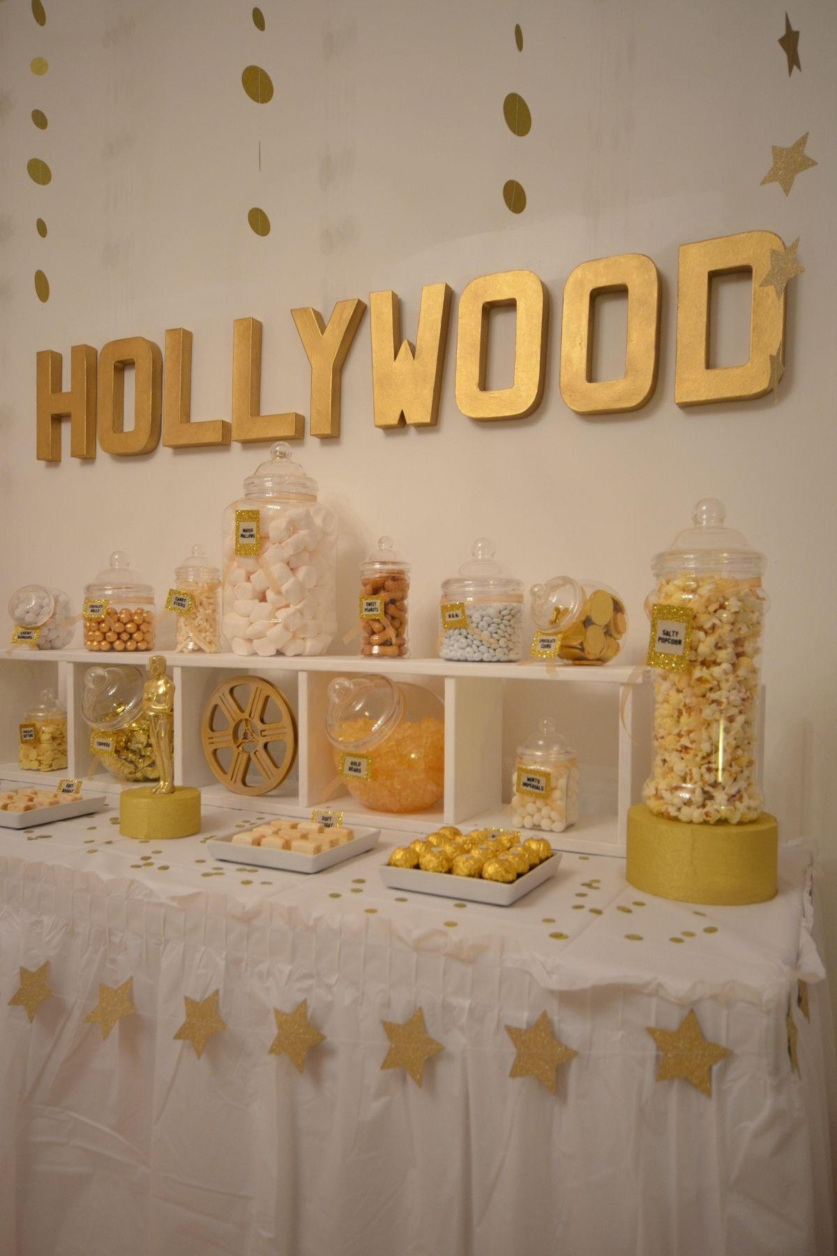 Gold and white hollywood sweet table bespoke party for Gold party