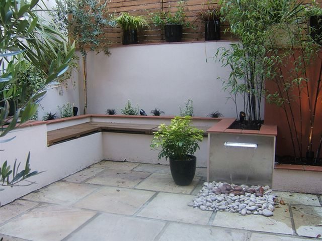 Integrated seating saves space does away with the for Very small courtyard ideas