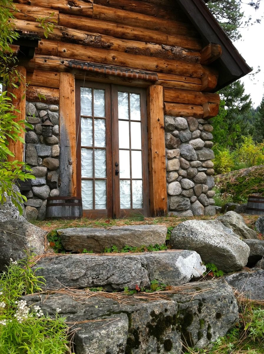 I like the wood stones and windows it 39 s not intentionally planned but comes together in a - The wood cabin on the rocks ...