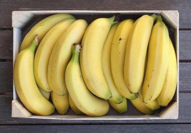 Wooden box of bananas.