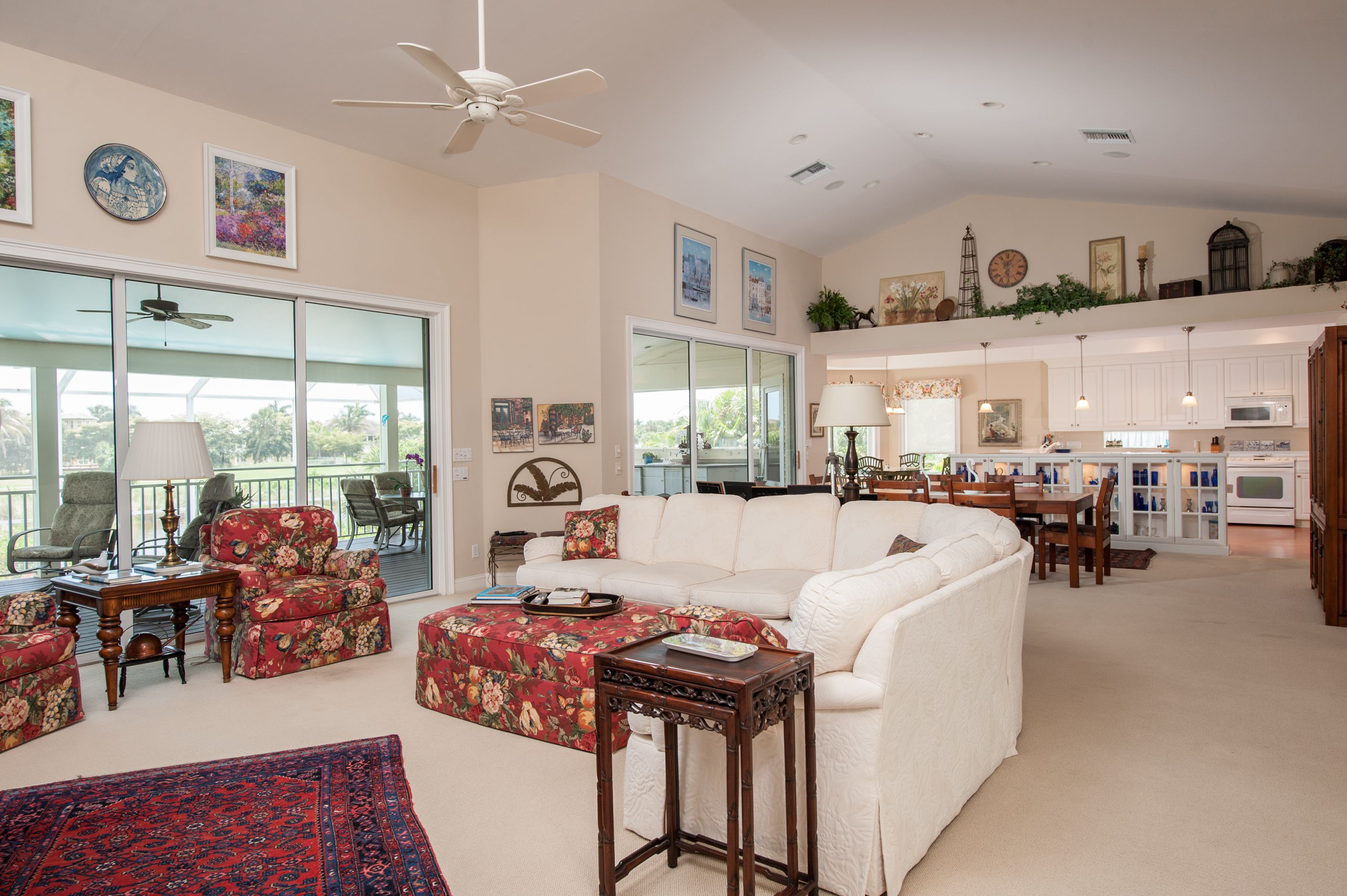 The Great Room Boasts Soaring Vaulted Ceilings With Display Ledges Stunning Library Den Boasts A Wall Of B Ledge Decor Above Kitchen Cabinets Decor Ideas Home Living room vaulted ceiling ledge