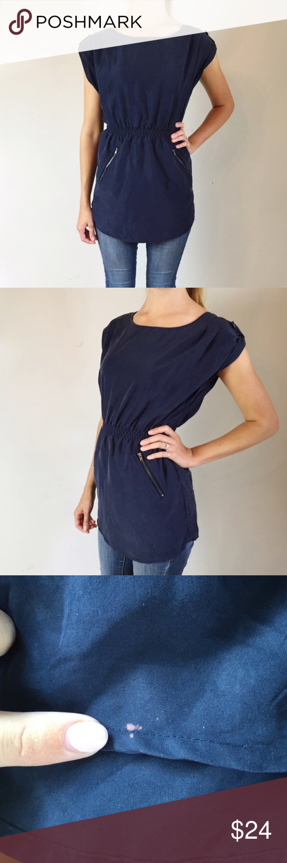 """H&M Navy Tunic This flattering tunic is fitted at the waist and has trendy zipper details at the back neckline and enclosing the front pockets. Ultra cool and light weight material. There is a very small pink spot at the hem as pictured. • Half pleats at shoulder  • Snap tab at shoulder • Wide neck  • Bust 19""""  • Waist 11""""-16"""" • Length 29""""  • 70% Modal • 30% Polyester Divided Tops Tunics"""