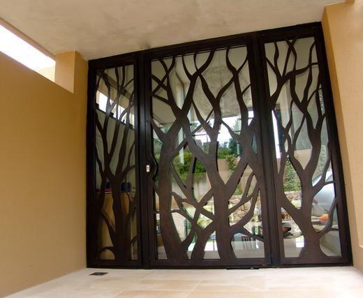 Porte fer forge et grille fer forge arabys metal art for Tete de fenetre