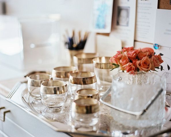 Silver-rimmed glasses and an ice bucket on a tray