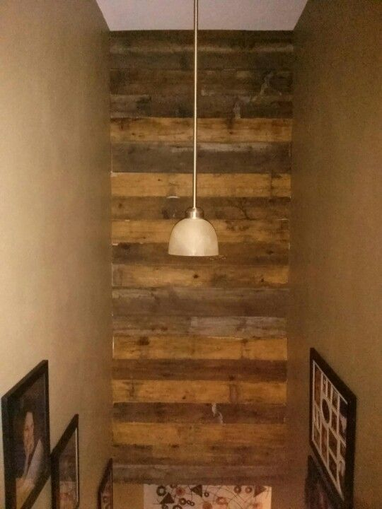 We used old wood siding planks on the wall above our basement stairway. Love it!
