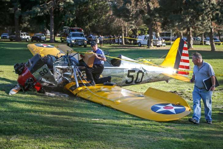 An airplane sits on the ground after crash landing at