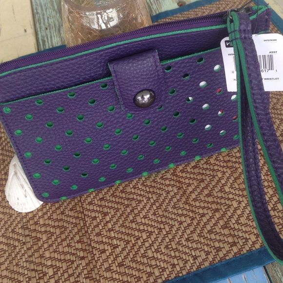 """Wristlet by Mundi Details: This is called """"Flat Front Pocket Wristlet.""""  Outside: Purple with green polking through the open circles.  Front pocket with a working snap.  Zipper to close.  Inside: Green fabric.  Slip pockets for credit cards/ID.  Man-made materials Measurements:  7.5"""" X 4.5""""  NWT (priced to sell) Mundi Bags Clutches & Wristlets"""