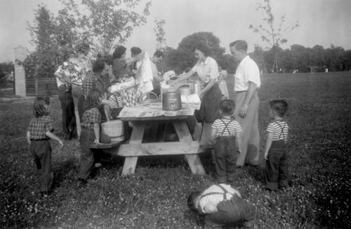 Friends and family gather for a picnic in Columbus, Ohio, ca. 1950.