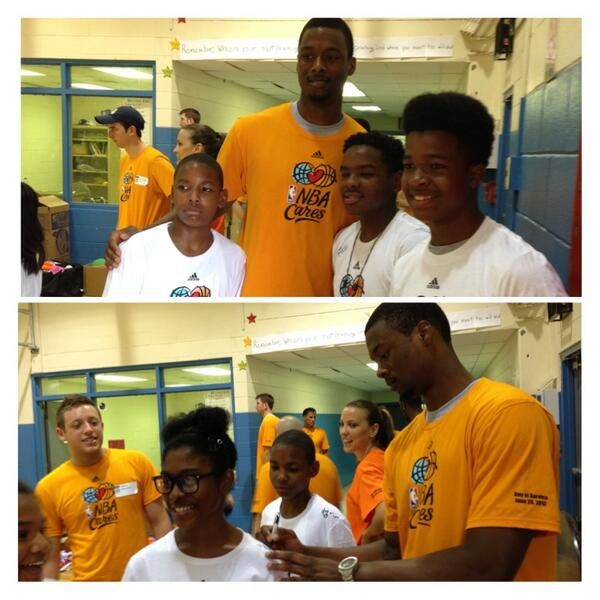 Harrison Barnes takes photos and signs autographs as part of @NBA Cares Employee Day of Service.