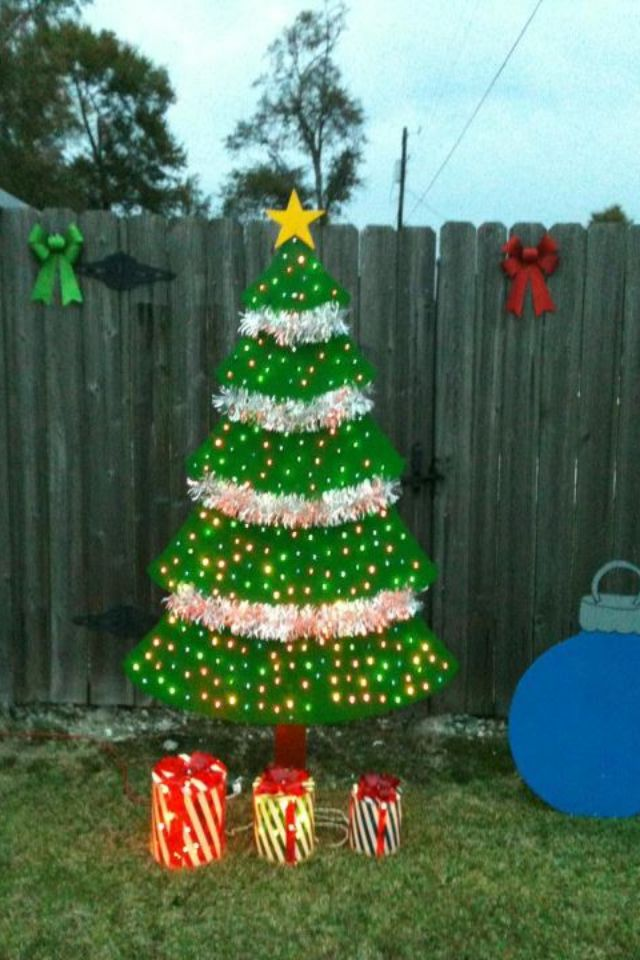 wooden christmas tree yard decor made out of plywood 250 lights and some garland