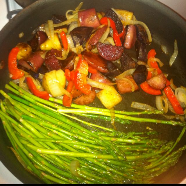Healthy and yummy, in 1 pan Heirloom potatoes chucked Little oil salt and garlic, cook covered 15-20 stirring Add onion, bell pepper sir Add asparagus and a little oil salt and garlic, cook covered 5-10 stir