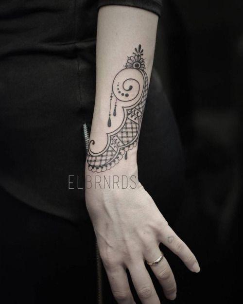 Ornamental Bracelet Tattoo On The Left Wrist Tattoo