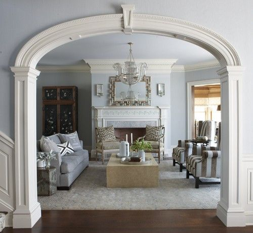 From Entry Hall With Elliptical Arch Separating Living Room A Classic Ct Home With A Modern Fl Living Room New York Traditional Living Room Elegant Interiors