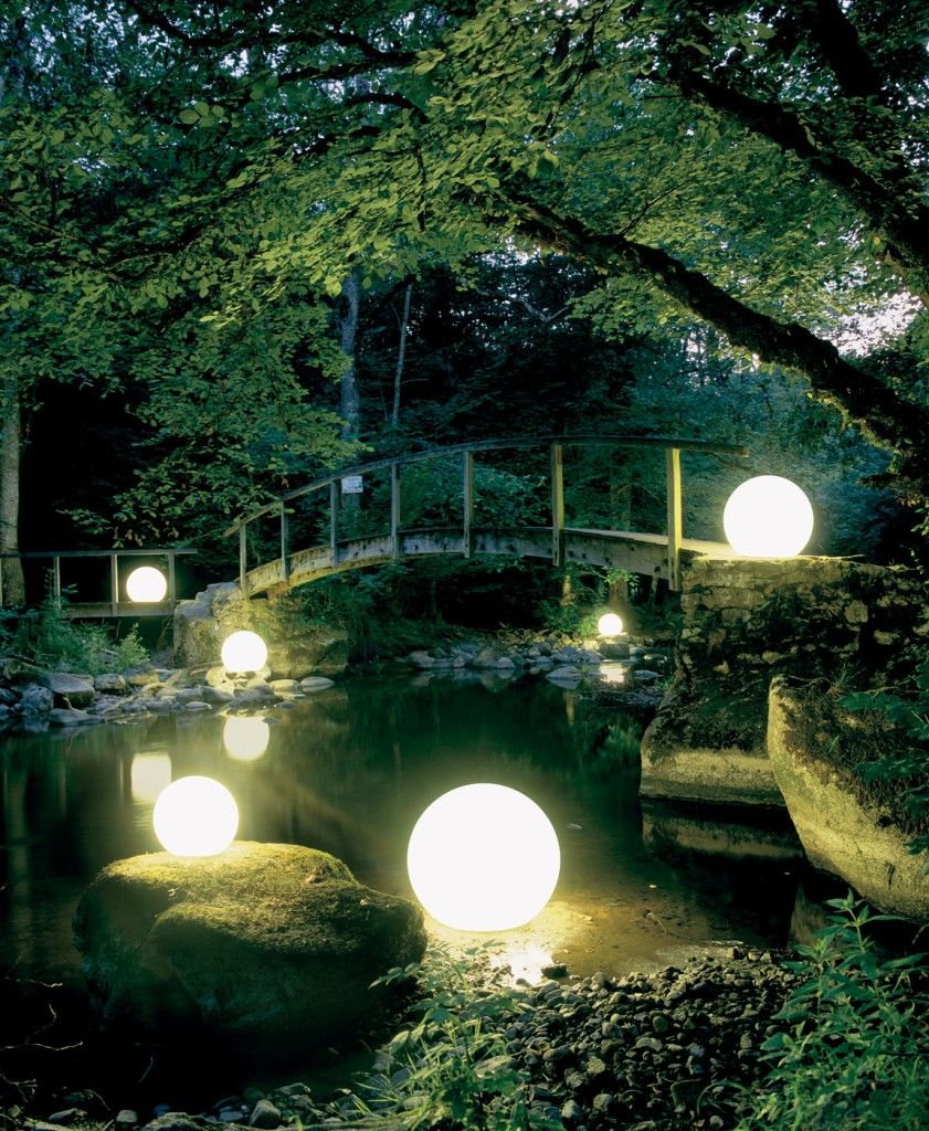 floating glow orbs moonlight gardens and water