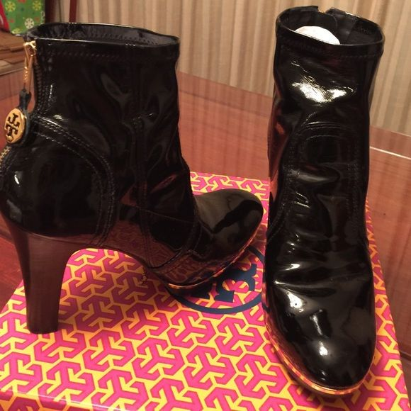 Tory Burch Melrose black patent leather booties Super comfy and fashionable black patent leather ankle boots.  Gold accents and back zipper with logo pulls.  Only worn a few times.  4 1/2 inch platform heel.  I hate to part with it but need room in my closet! Tory Burch Shoes Ankle Boots & Booties