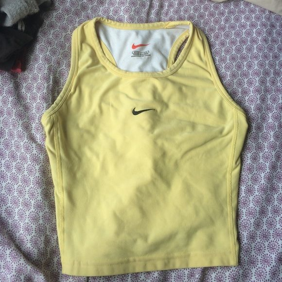 Small yellow Nike workout crop top with bra Built in bra. Nike Tops Tank Tops