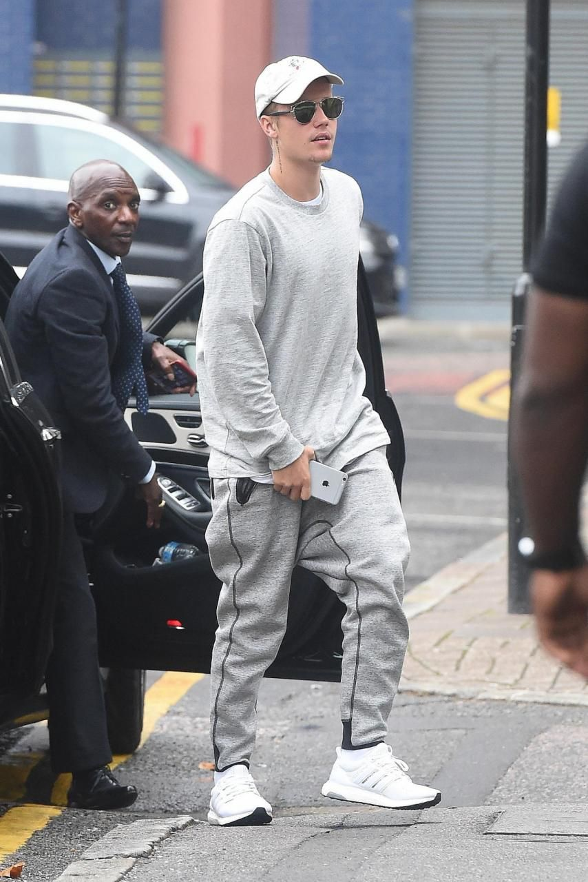 Justin Bieber wearing Urban Outfitters Snoopy Baseball Cap, Dior Dior  Technologic Sunglasses in Palladium, Adidas Ultra Boost in White/Silver  Metallic, ...