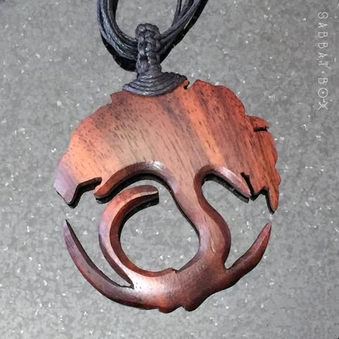 This unique Triquetra Necklace has been meticulously carved from wood and comes with a multi-strand cord. It has been hand stained in an dark mahogany color, making this a magickal necklace for both m