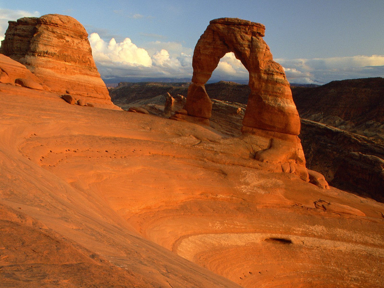 Delicate Arch is developed at the contact between the Slick Rock Member and  the Moab Member of the Entrada Sandstone.