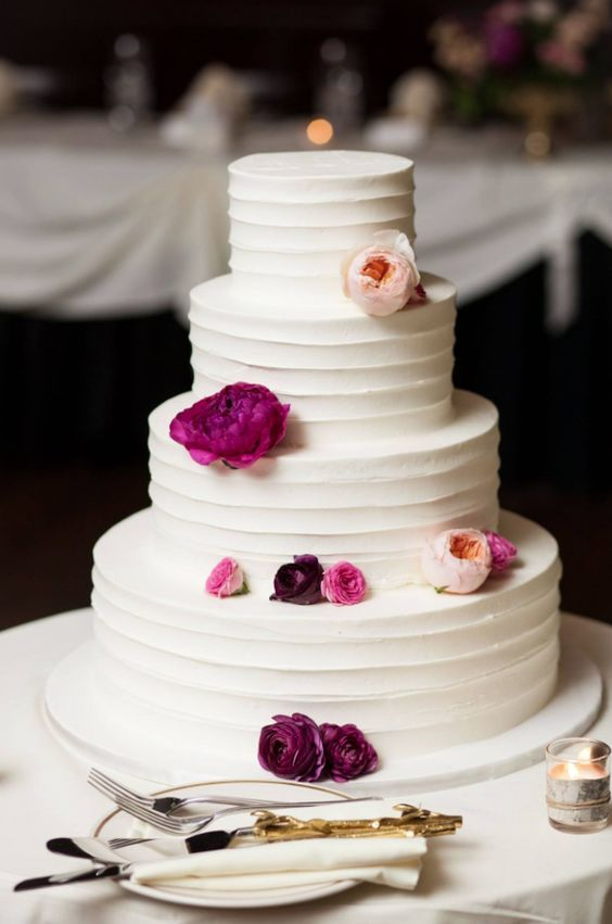 Gorgeous four tier dark pink flower detailed white wedding cake; Featured Photographer: Natalie Probst Photography, Featured Cake: Alliance Bakery