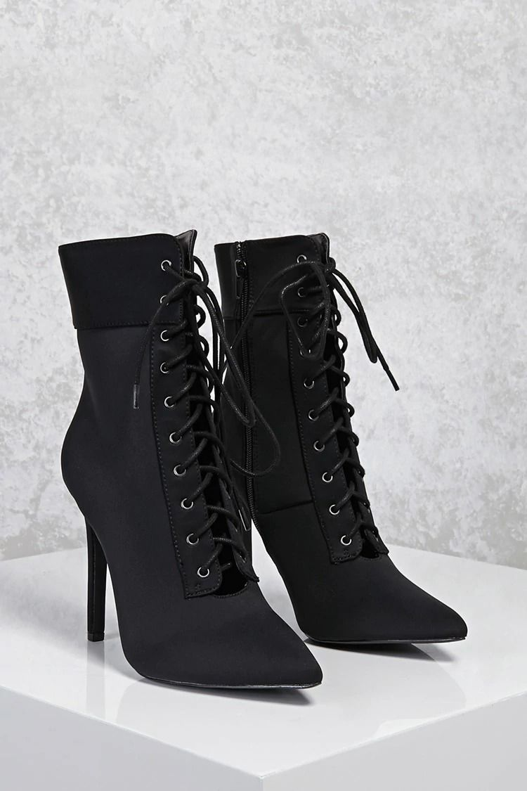 A pair of lycra pointed toe ankle boots featuring a laceup front an