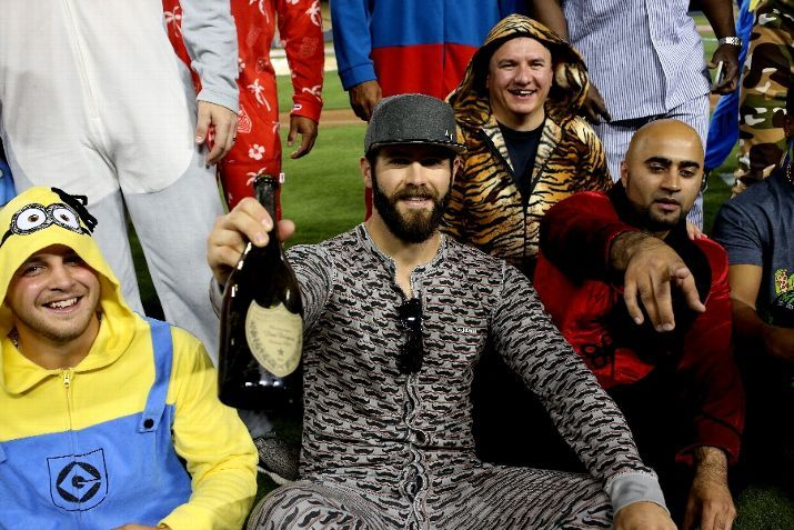 Jake Arrieta, CHC, celebrates his no-hitter v LAD with champagne as the Cubs leave the West Coast on a team theme flight to Chicago, Aug 2015.