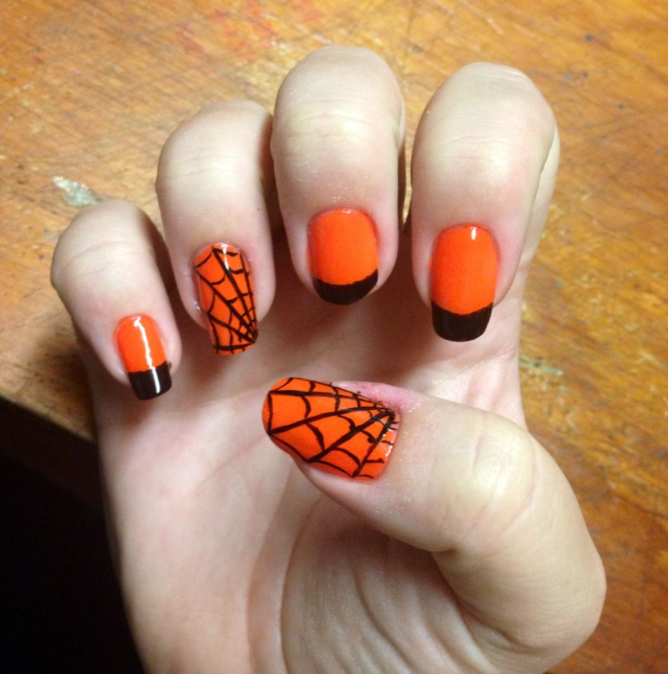 Halloween nail art Neon orange with black tips and a few ...