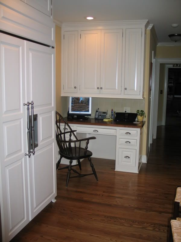 layout good, open to hallway, but upper cabinets come down ...