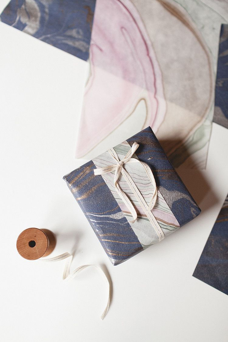 DIY layered wrapping paper is the perfect tutorial for using every scrap of gift wrap and making gorgeous, unforgettable presents! learn this easy technique over on jojotastic.com