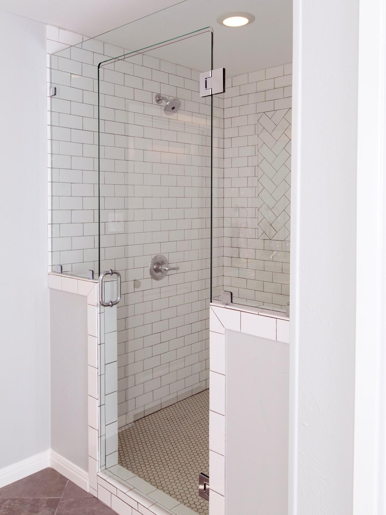 Shower Subway Tile white subway tile is an unexpected touch to this white