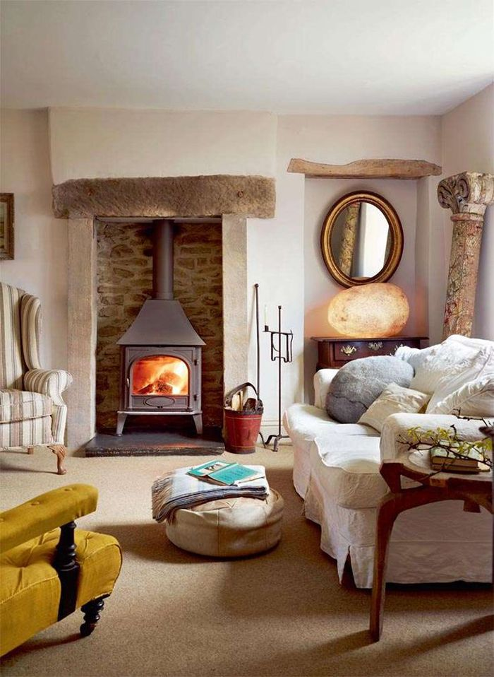 country cottage living room slipcovered sofa | stove ...