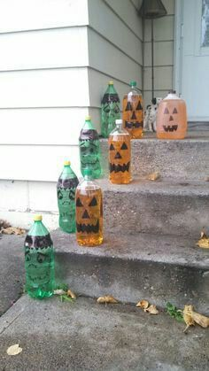 Soda Bottle Halloween Decorations Diy Simple Fill Bottles With Water Draw Faces On The Green Bottles Add Pop Bottle Crafts Bottle Crafts Soda Bottle Crafts