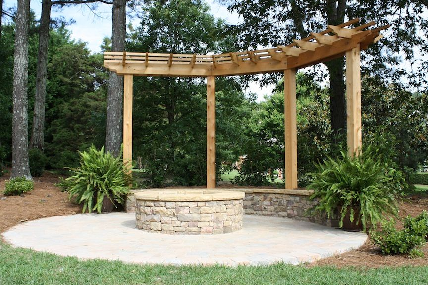 Paver Patio With Pergola, Stacked Stone Firepit And Seating Wall