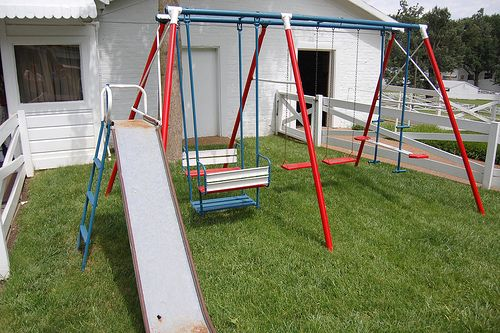 Swing Sets;  lifted up out of the ground when we would swing too high!
