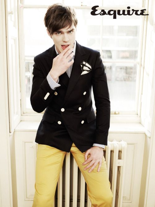 Nicholas Hoult in yellow pants.