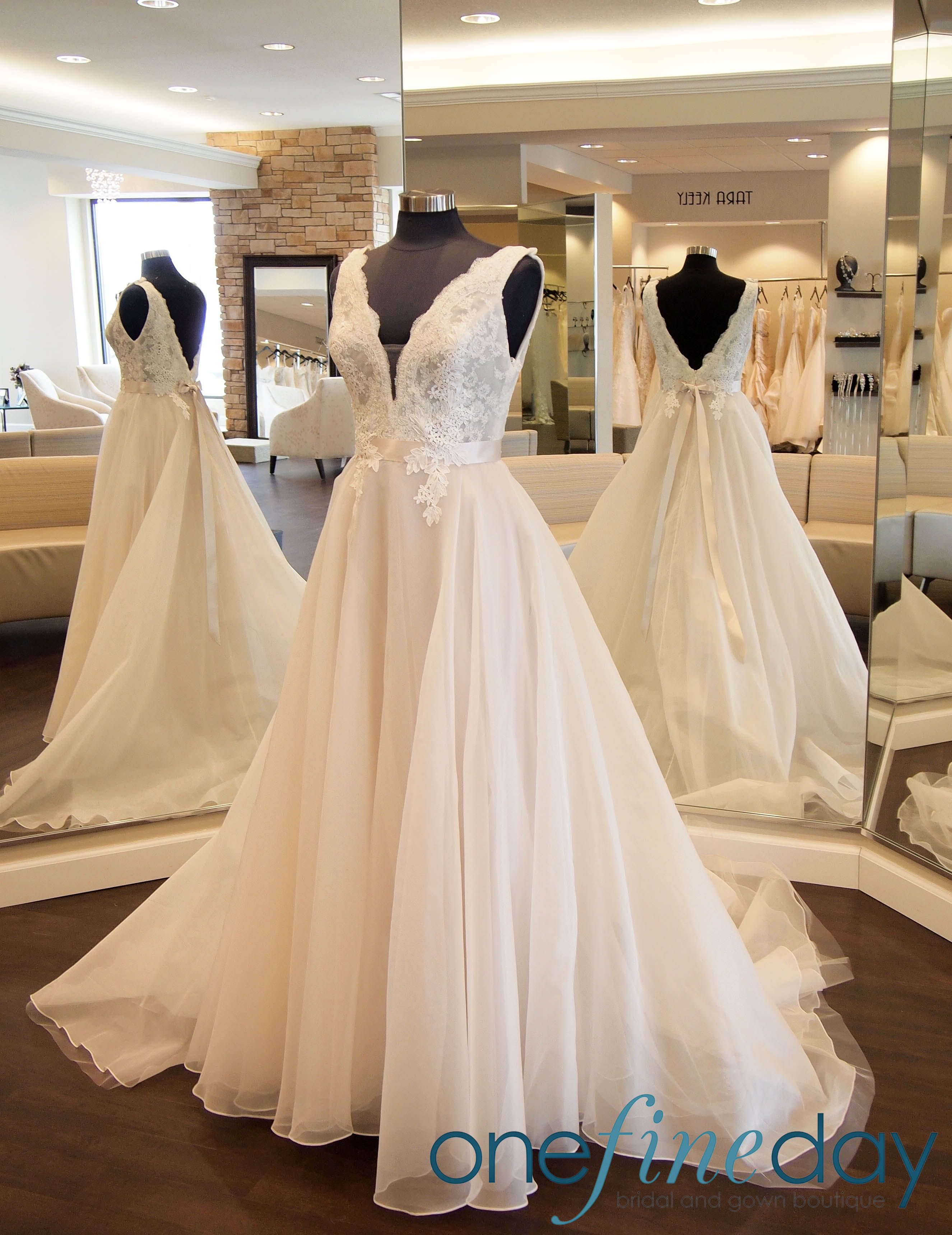 Top dresses to wear to a wedding  Tara Keely  is an organza ballgown with lace bodice She