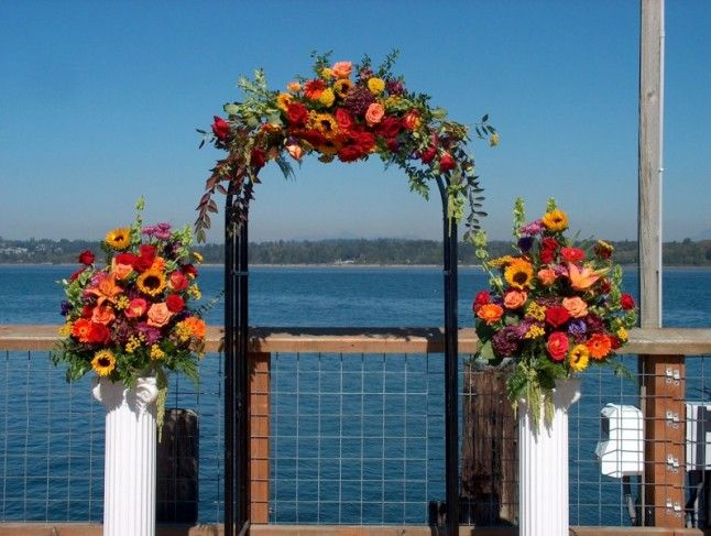 decorated wedding arch white trelles paneling decorated for a autum wedding 3347