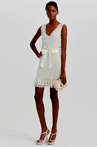 Marchesa's Embroidered tulle dress with ribbon waist.