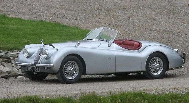 Fancy Ride A Classic Silver Sports Car Was Also Pictured At The