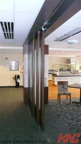Crowders Come Along System is used as a large sliding room divider